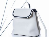 White women`s leather backpack. Fashion bag on white background royalty free stock photo