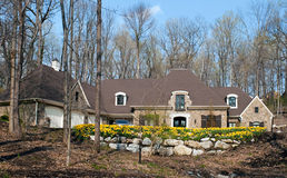 Exclusive House with Spring Daffodils Stock Photography