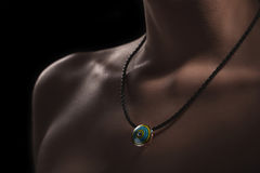 Exclusive jewelry accessories concept. dark picture with bright necklace on woman body. Exclusive jewelry accessories concept. dark picture with bright necklace royalty free stock photo