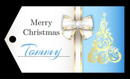 Luxury light blue Christmas name tag with golden o. Exclusive lightblue Christmas name tag with golden ornament Christmas tree and white ribbon Royalty Free Stock Photo