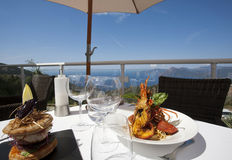 Exclusive lunch near the sea Stock Photography