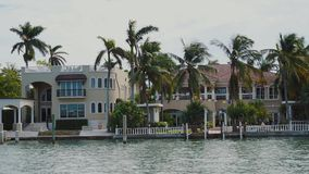 Exclusive mansions of celebrities with tropical trees on the shore of star island,sunny isles beach,miami. Beautiful wealthy villas of famous people on the bay stock video