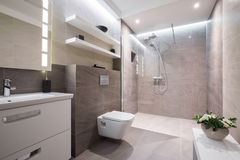 Exclusive modern bathroom. Exclusive modern white bathroom with glass shower royalty free stock photography