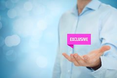 Exclusive offer. And exclusivity business model. Businessman hold virtual label with text exclusive. Right composition with bokeh in background Royalty Free Stock Photography