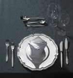 Exclusive place setting on dark tablecloth Stock Photo