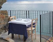 Exclusive Restaurant overlooking the sea, romantic dinner for two stock photography