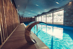 Exclusive swimming pool in a wellness hotel.Luxury resort indoor swimming pool with beautiful clean blue water Stock Photos