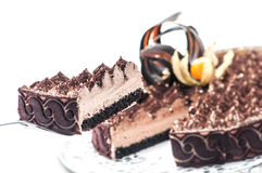 Exclusive tiramisu with cocoa and chocolate decoration on top, piece of cream cake, patisserie, photography for shop, sweet desser Stock Photo