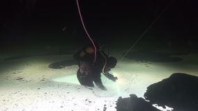 Exclusive trick diver on double bottom underwter in ice of White Sea. stock video