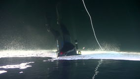 Exclusive trick diver underwter in ice of White Sea. Creative diving and dangerous extreme sport. Unique shooting stock video footage
