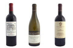 Exclusive wine. 3 bottles of exclusive french wine, separated on the white background stock image