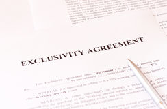 Exclusivity agreement form with pen. Pic stock photography