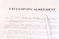 Exclusivity agreement form with pen. Pic Royalty Free Stock Image