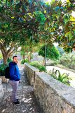 Excurionist. Young man in a park, Alberobello, Italy Royalty Free Stock Image