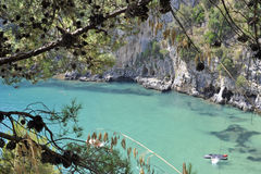 Excursion. Turquoise seawater along characteristic Palinuro coast, Italy Stock Photo
