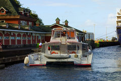 An excursion boat approaching the cruise ship wharf at kingstown Royalty Free Stock Photography
