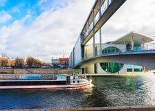Excursion boat at bridge at German Bundestag Parliament building. Berlin, Germany - December 8, 2017: Excursion boat at the bridge at German Bundestag Parliament stock photography