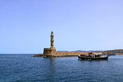 Excursion boat cruising Venetian harbour and mediterranean sea of Chania, Crete, Greece. Excursion boat cruising Venetian harbour and mediterranean sea of Chania stock image