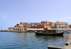 Excursion boat cruising Venetian harbour and mediterranean sea of Chania, Crete, Greece. Excursion boat cruising Venetian harbour and mediterranean sea of Chania royalty free stock photo