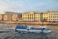Excursion boat on the Fontanka River. Saint-Petersburg Royalty Free Stock Photo