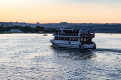 Excursion boat in Golden Horn bay in Istanbul city. Travel to Turkey - excursion boat in Golden Horn bay in Istanbul city in spring evening Stock Photography