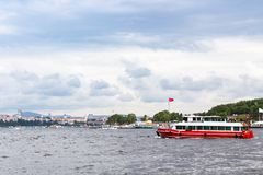 Excursion boat in Golden Horn bay in spring. Travel to Turkey - excursion boat in Golden Horn bay in Istanbul city in spring Royalty Free Stock Image