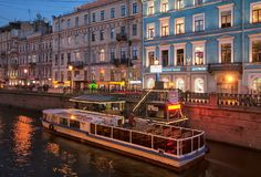 Excursion boat on Griboyedov Canal. St. Petersburg. Russia. SAINT - PETERSBURG, RUSSIA - NOVEMBER 2, 2017: Excursion boat with tourists on the pier of Griboyedov Royalty Free Stock Image