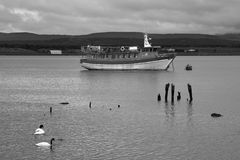 Excursion boat in the harbor of Puerto Natales. Royalty Free Stock Photo
