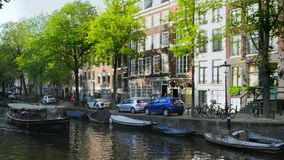 Tour Boat at a Canal in Amsterdam, Netherlands. Excursion Boat at the Leidsegracht Canal in Amsterdam, Holland, Netherlands, Europe stock footage
