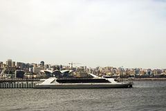 Excursion boat moored to the pier for the winter season in the Baku Bay of the Caspian sea, Azerbaijan. 2018 royalty free stock image