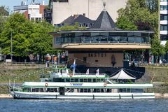 Excursion boat RHEINLAND of Kölntourist on the river Rhine in Cologne, Germany. RHEINLAND has a capacity up to 308 passengers and is 37 m long Royalty Free Stock Photos