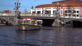 Shooting in the motion from canal sightseeing cruise boat in Amsterdam stock video