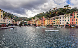 Excursion boat at the stormy bay of Portofino town, Italy Stock Photos