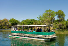 An excursion boat on a sunny day in florida Royalty Free Stock Image