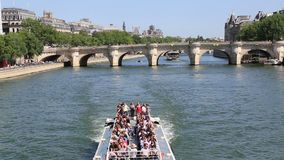 Tour boat on the Seine river in Paris, France stock video