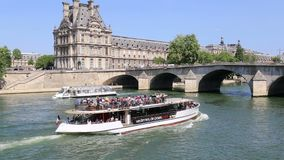 Tour boat on the Seine river in Paris, France stock footage