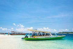 Excursion boat at tropical coast of Gili Trawangan, Indonesia Stock Photo