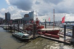 Excursion boats on the Elbe river near the Hamburg, St Pauli Landungsbruecken.  Royalty Free Stock Photography