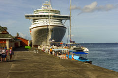 Excursion boats lined up to collect passengers from azura. A massive cruise ship berthed at a cruise ship facility in the windward islands Royalty Free Stock Photos