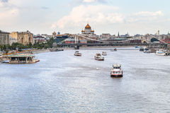 Excursion boats near Krymsky Bridge, Moscow. Excursion boats in Moskva River near Krymsky Bridge, Moscow, Russia stock photo