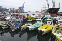 Excursion boats parked at the harbor in Valparaiso, Chile. VALPARAISO, CHILE - OCTOBER 19, 2010: Excursion boats tied at the harbor of Valparaiso on October 19 Stock Photo