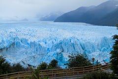 Excursion bridge at glacier Perito Moreno in Patagonia, Argentina. Excursion bridge at blue ice glacier Perito Moreno in Patagonia, Argentina. Biggest mountain stock photo