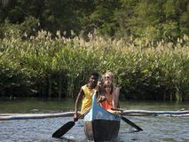 Excursion with canoe, pirogue in the river stock images