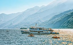 Excursion ferry at Ascona luxury tourist resort on Lake Maggiore. Excursion passenger ferry at Ascona luxury tourist resort on Lake Maggiore in Ticino canton in stock photos
