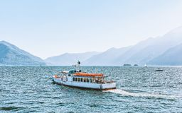 Excursion ferry in Ascona luxury tourist resort on Lake Maggiore. Excursion passenger ferry in Ascona luxury tourist resort on Lake Maggiore in Ticino canton in royalty free stock images