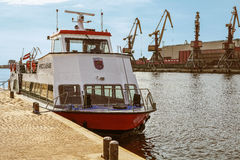 Excursion Ferry docked on the Venta River in Ventspils Stock Images