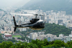 Excursion helicopter taking off and Botafogo in Rio de Janeiro Stock Photos