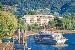 Excursion passenger ferry on Ascona luxury tourist resort in Lake Maggiore. Ascona, Switzerland - August 23, 2016: Excursion passenger ferry on Ascona luxury stock photography