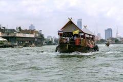 Excursion and pleasure boats sail on Chao Phraya river in Bangkok Stock Photo
