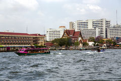 Excursion and pleasure boats sail on Chao Phraya river in Bangkok Royalty Free Stock Photo
